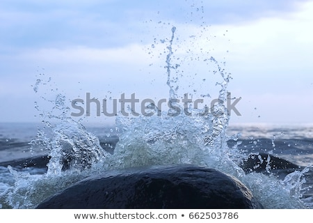 Shore of the sea, stones  and flowing water  Stock photo © Taiga