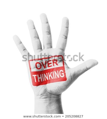 Stop túlevés felirat festett nyitva kéz Stock fotó © tashatuvango