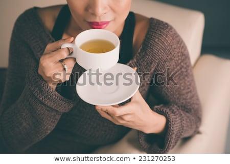 Méconnaissable femme maison thé tasse manger Photo stock © HASLOO