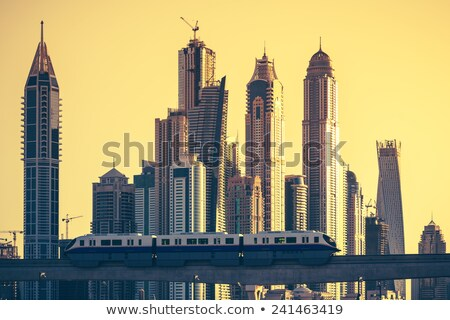 dubai with subway and skycrapers at sunset stock photo © vwalakte