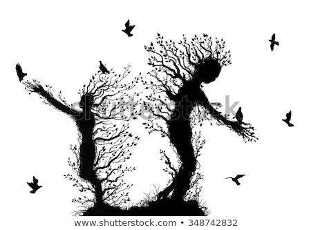 Mains permanent comme arbre oiseau silhouette Photo stock © vgarts