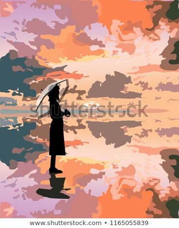 beautiful girl standing in the sea in a landscape stock photo © -baks-