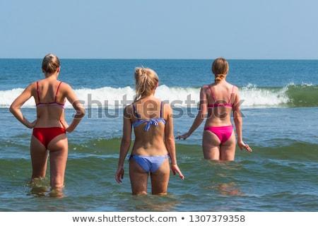 fit woman in bikini standing on the beach stock photo © wavebreak_media