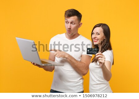 portrait of amazed man holding laptop computer stock photo © deandrobot