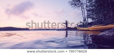 pesca · montana · río · puesta · de · sol · cielo · nubes - foto stock © nialat