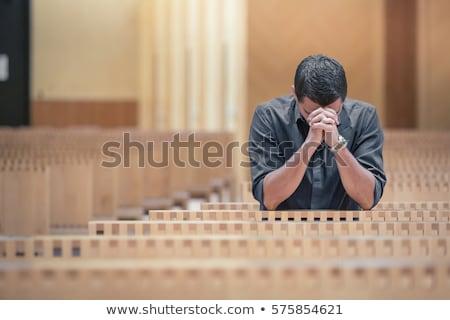 Hristiyan adam dua eden eller katlanmış parmaklar Stok fotoğraf © stevanovicigor