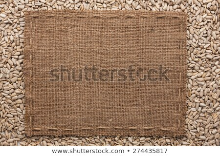 Frame made of burlap with the line and sunflower seeds lies whit Stock photo © alekleks