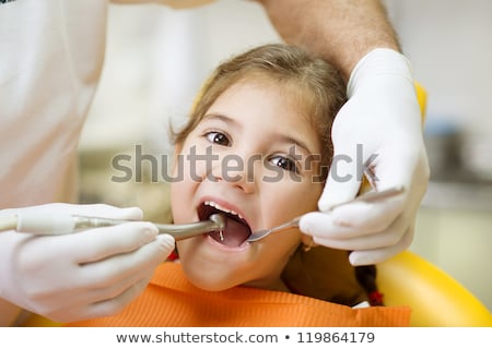 Patient having dental tooth cleaning at dentist Stock photo © Kzenon