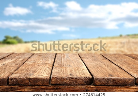 old empty wooden table top with sunset background stock photo © punsayaporn