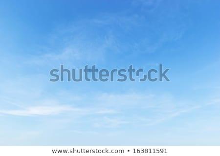 Pelucheux ciel bleu soft nuages Photo stock © meinzahn