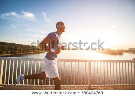 afroamerikai · fiatalember · fut · reggel · portré · nap - stock fotó © deandrobot