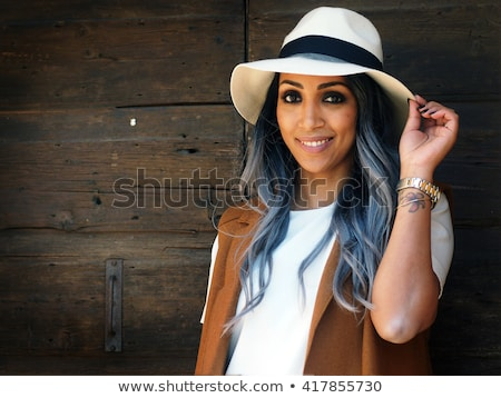 Stock photo: Smiling woman in tight white shirt