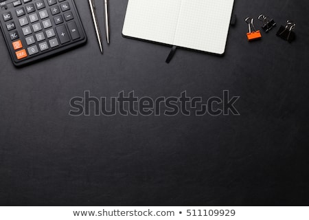 office leather desk table with calculator and notepad stock photo © karandaev