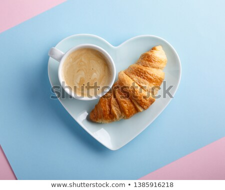 heart shaped bread on blue plate love concept stock photo © rafalstachura