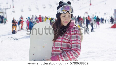 cute asian female snowboarder relaxing on slope stock photo © dash