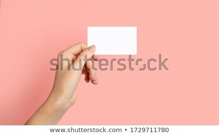 Female hand holding blank mockup banner sign as copy space Stock photo © stevanovicigor