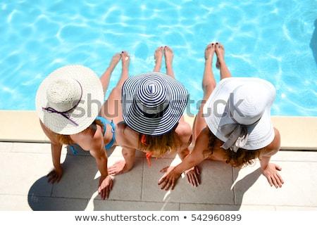 giovani · donna · bionda · rilassante · piscina · indossare · occhiali · da · sole - foto d'archivio © bezikus