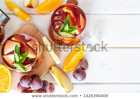 Sangria  and ingredients in glasses  on a rustic wood Stock photo © Yatsenko