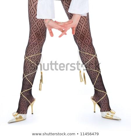 Beautiful long woman's legs in black net pantyhose Stock photo © Nobilior