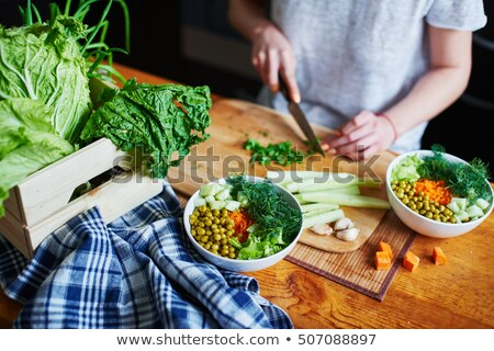 Female Hand Chopping Green Onions Stock photo © paulinkl