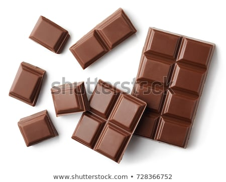 Top view of crushed dark chocolate bar with sweets Stock photo © deandrobot