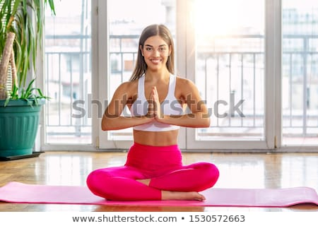 Woman sitting in yoga position at home Stock photo © IS2