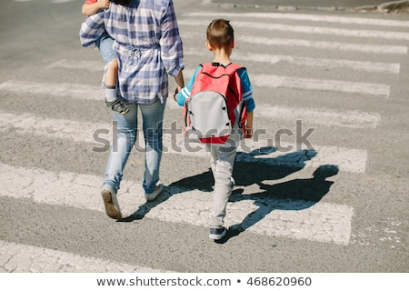 family of three walking up the road Stock photo © IS2