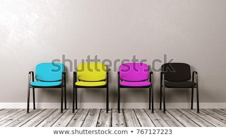 Quattro colorato sedie grigio muro Foto d'archivio © make