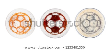 Glass of stout beer top with football shape Stock photo © DenisMArt