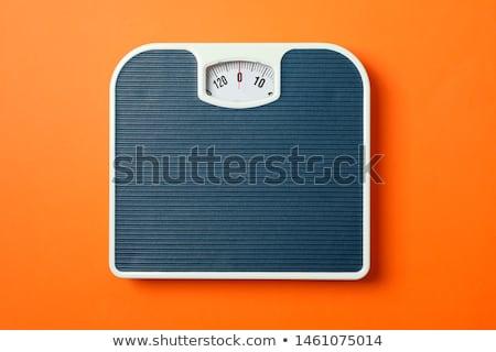 Oranges on scales Stock photo © Fotografiche