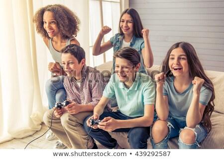 Garçon fille console de jeux amusement soutien jeu Photo stock © IS2