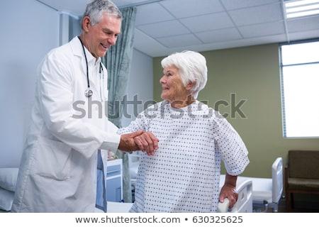 Medico paziente letto ospedale comunicazione nero Foto d'archivio © wavebreak_media