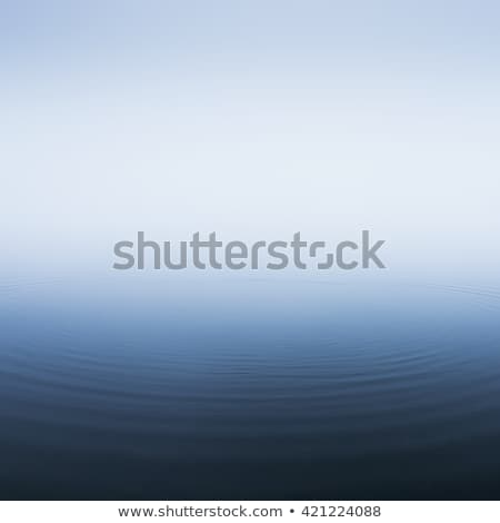 white fog with blue water sea surface stock photo © sidmay