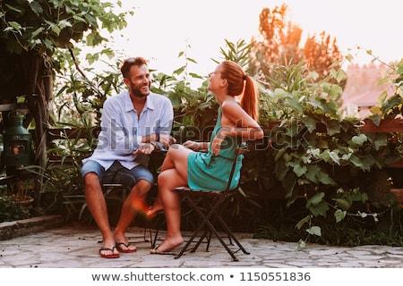 Couple séance jardin terrasse vin table Photo stock © IS2