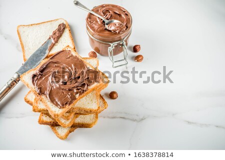 two bread slices with chocolate hazelnut spread stock photo © manaemedia