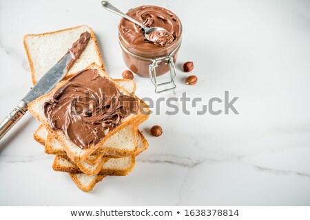 Two bread slices with chocolate hazelnut spread Stock photo © manaemedia