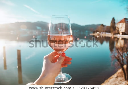 Women hand with a glass of rose wine Stock photo © FreeProd
