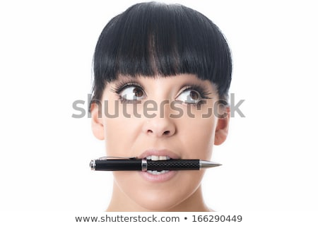 A young girl in the office holds a pen in her mouth and works with a calculator, documents and a com Stock photo © Traimak