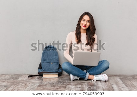 young woman with bag and pc stock photo © traimak