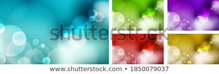 Bright blue green and yellow bokeh circles on a green natural background. Blurred foliage. Stock photo © artjazz