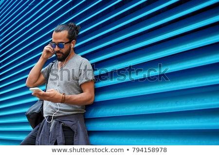 Férfi fülhallgató okostelefon táska utca emberek Stock fotó © dolgachov