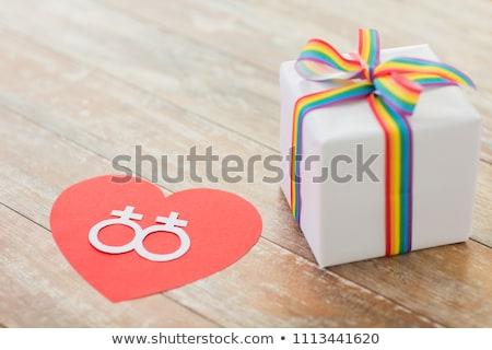 ストックフォト: Gift With Gay Awareness Ribbon And Venus Symbol
