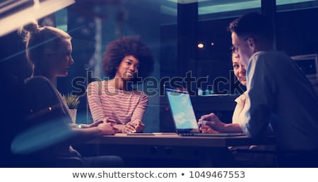 business team with coffee working at night office Stock photo © dolgachov