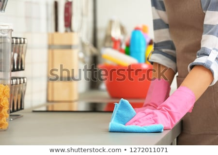 Stockfoto: Woman Cleaning Dirty Kitchen Counter