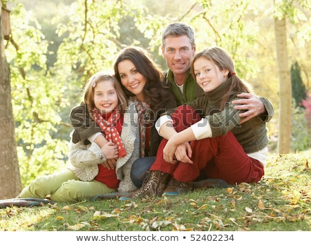 Man Sitting in Park, Family with Leaves Foliage Stock photo © robuart