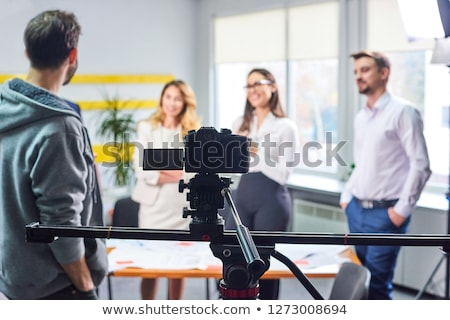 Film director discussing movie plan with the actors Stock photo © frimufilms