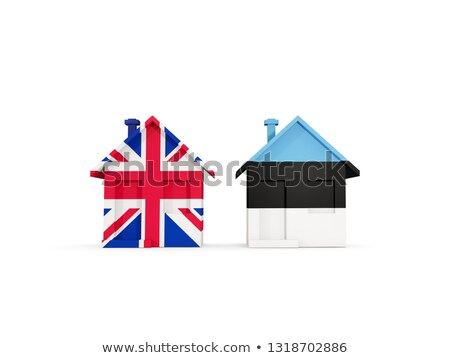 Stock photo: Two houses with flags of United Kingdom and estonia