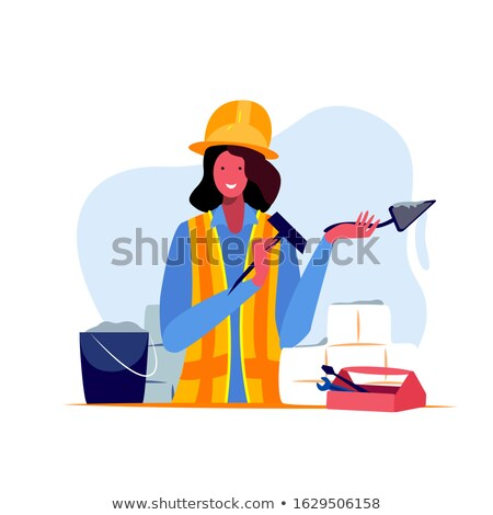 Builder woman build a brick wall Stock photo © netkov1