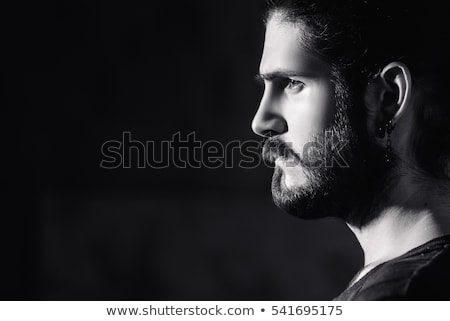 black and white portrait of young model with long hair stock photo © studiolucky