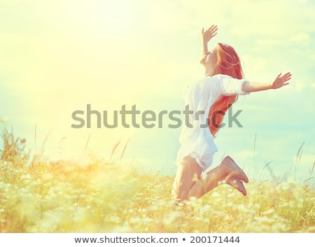 Young happy woman in green field Stock photo © Nobilior